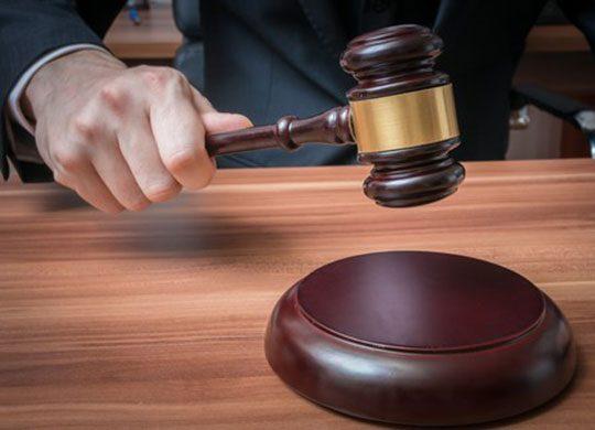 Photo of judge closing court case